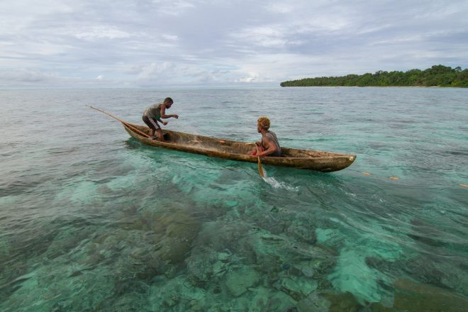 Two fisherman put out a net to catch reef fish, Fumato'o, Malaita Province, Solomon Islands. Photo by Filip Milovac.