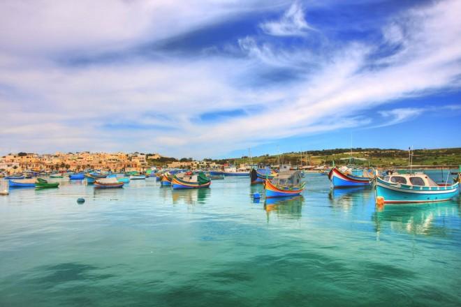 "Image: ""Marsaxlokk traditional Maltese fishing boats 2"" by Kev-1n, CC BY-NC-ND 2.0."
